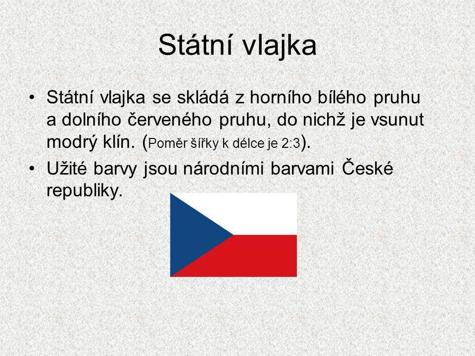 Státní vlajka Státní vlajka se skládá z horního bílého pruhu a dolního červeného pruhu, do nichž je vsunut modrý klín.