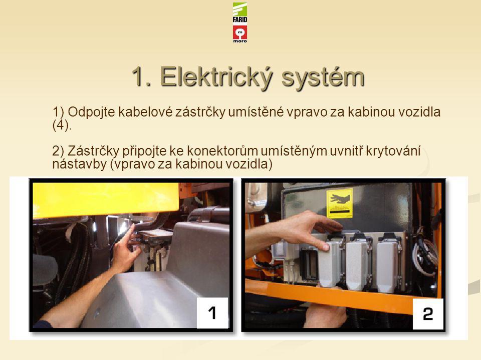 1. Elektrický systém 1) Odpojte kabelové zástrčky umístěné vpravo za kabinou vozidla (4). 2) Zástrčky připojte ke konektorům umístěným uvnitř krytován