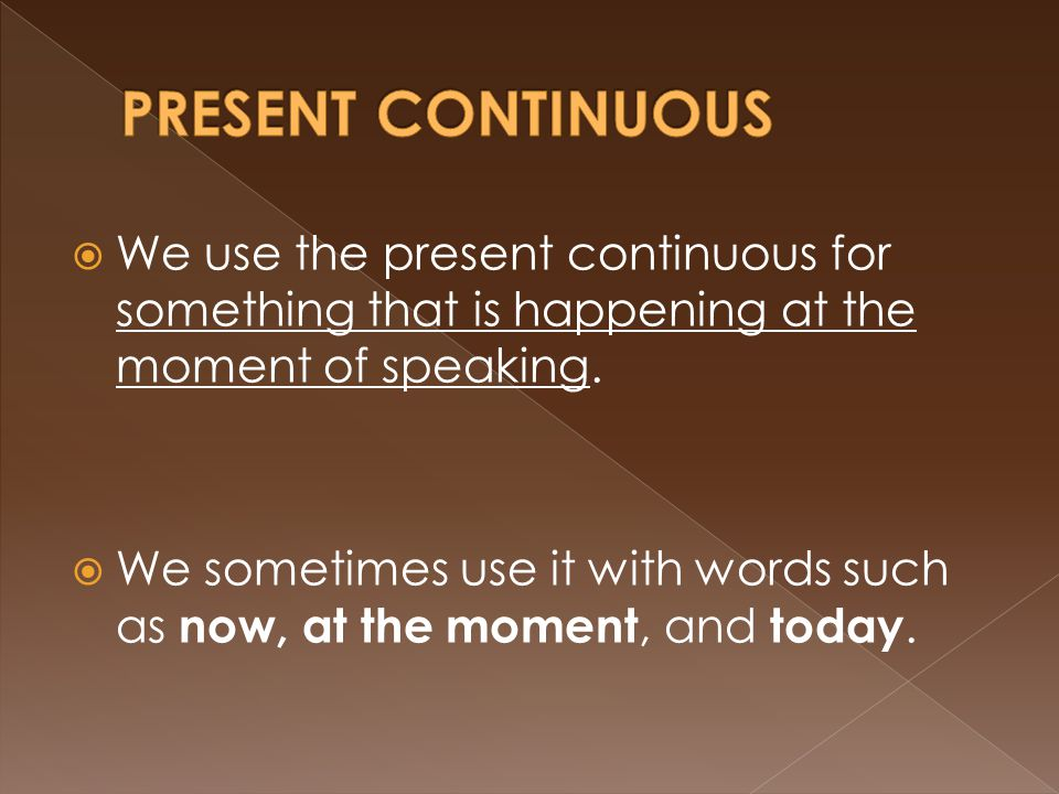  We use the present continuous for something that is happening at the moment of speaking.  We sometimes use it with words such as now, at the moment