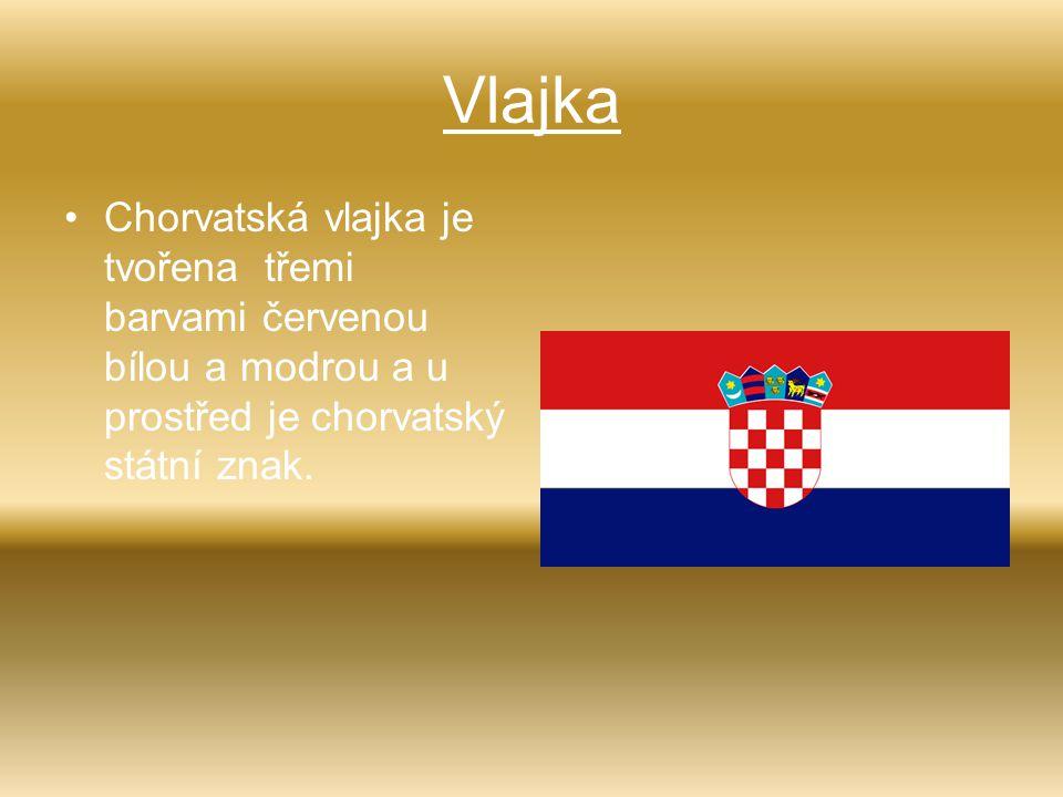 Vlajka Chorvatská vlajka je tvořena třemi barvami červenou bílou a modrou a u prostřed je chorvatský státní znak.
