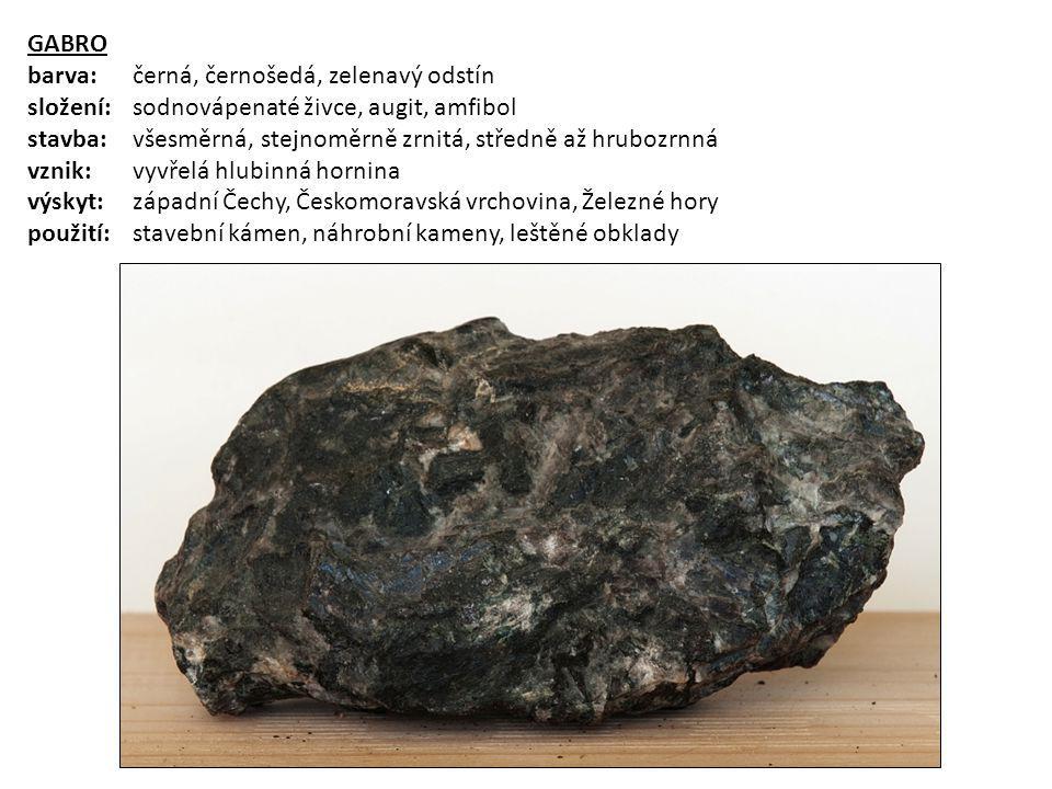 GABRO barva: černá, černošedá, zelenavý odstín složení: sodnovápenaté živce, augit, amfibol stavba:všesměrná, stejnoměrně zrnitá, středně až hrubozrnn