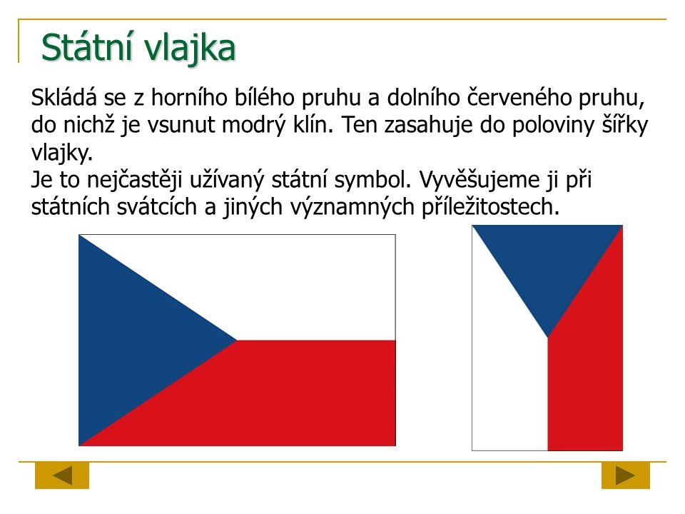 Státní vlajka Skládá se z horního bílého pruhu a dolního červeného pruhu, do nichž je vsunut modrý klín. Ten zasahuje do poloviny šířky vlajky. Je to