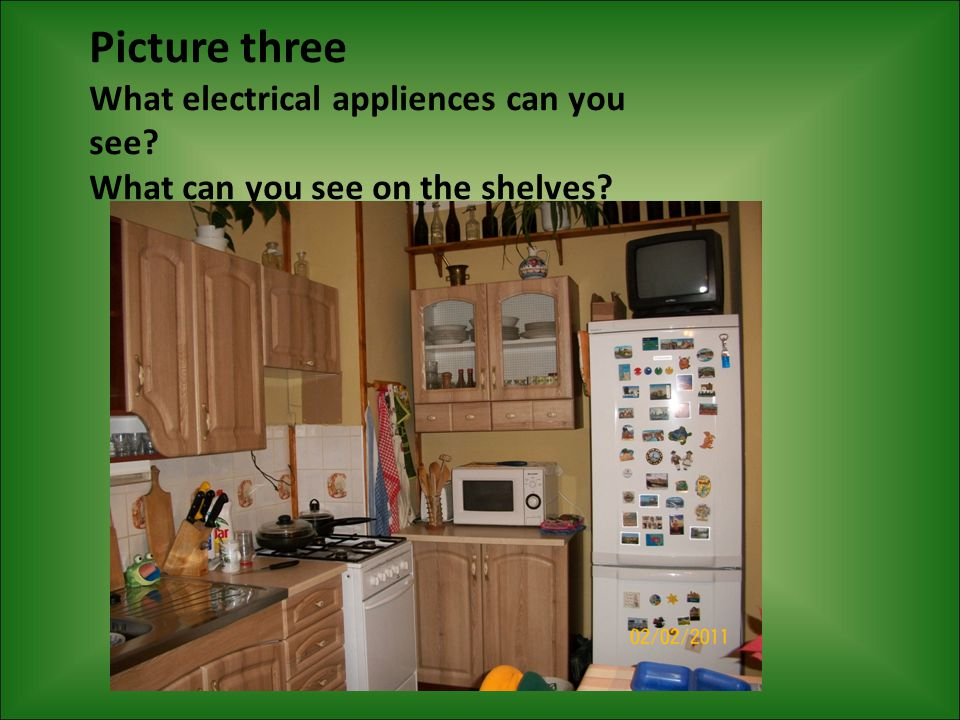 Picture three What electrical appliences can you see What can you see on the shelves