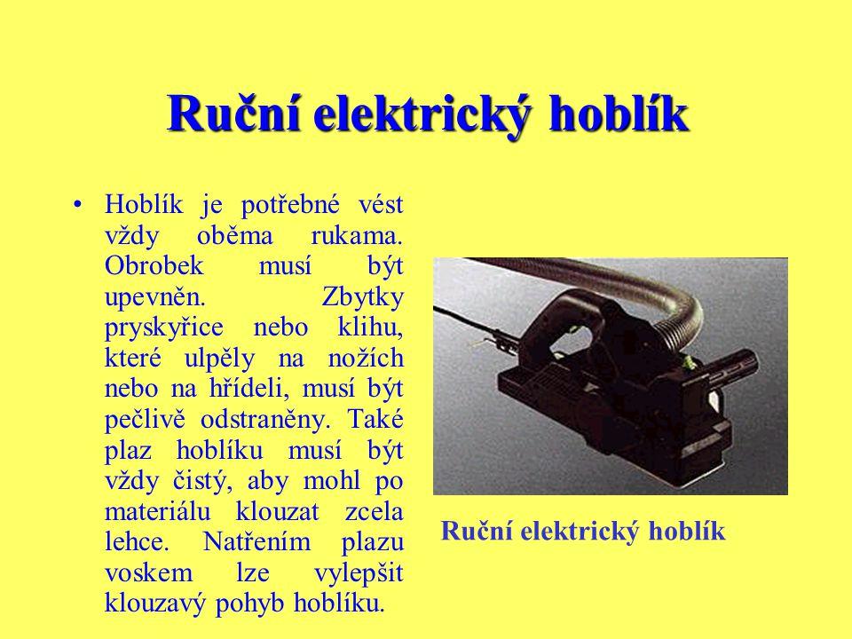 Ruční elektrický hoblík Nejdůležitější součástí elektrického hoblíku je rotující hřídel s vysokým počtem otáček (při běhu naprázdno až 15 000 otáček z