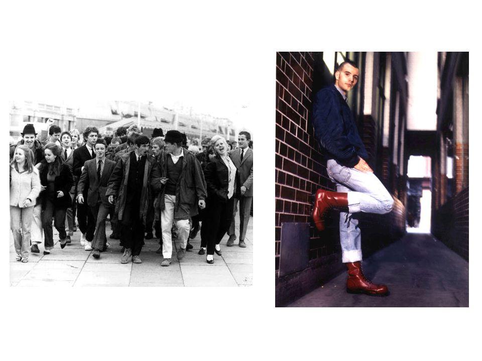 """Typické poznávací znaky Účes  muži - vyholená hlava  ženy - """"feathercut Oblečení  kostkované košile s krátkým či dlouhým rukávem  americké vojenské bundy pilotů, džínové bundy  dělnické kalhoty, maskáčové kalhoty  těžké boty, farmářky"""