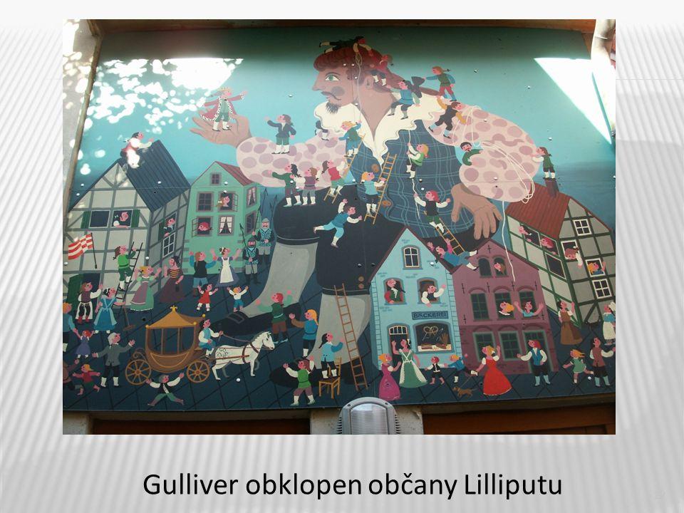 12 Gulliver obklopen občany Lilliputu