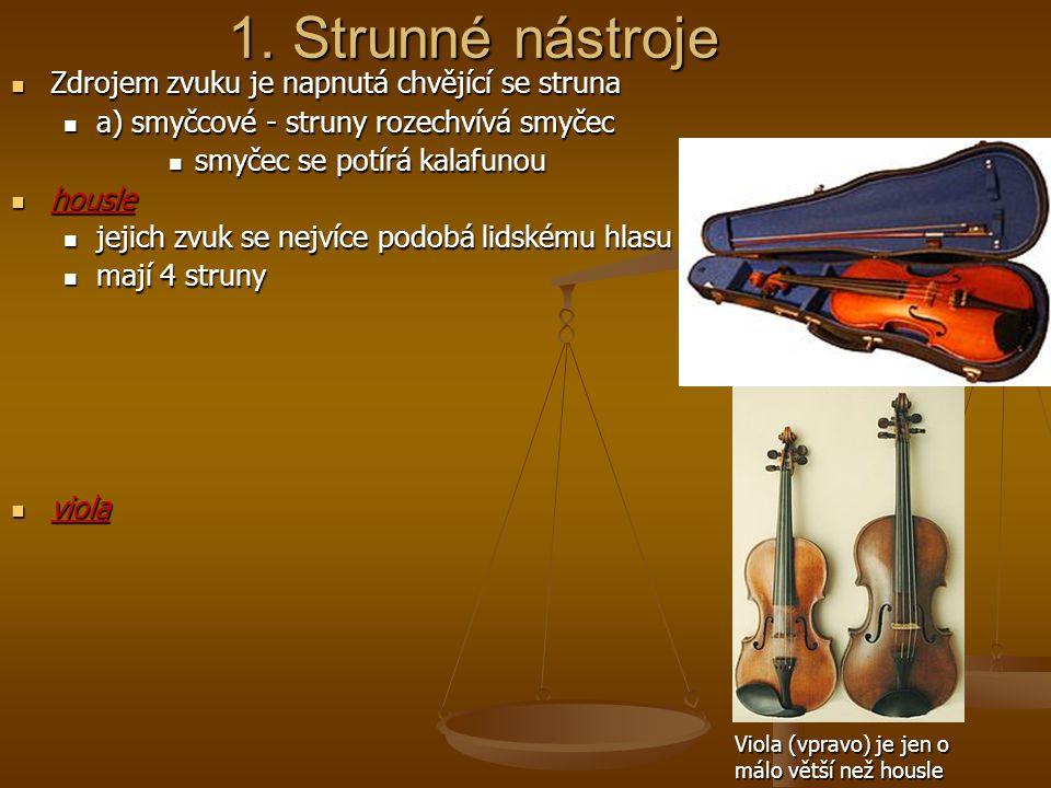 1. Strunné nástroje Zdrojem zvuku je napnutá chvějící se struna Zdrojem zvuku je napnutá chvějící se struna a) smyčcové - struny rozechvívá smyčec a)
