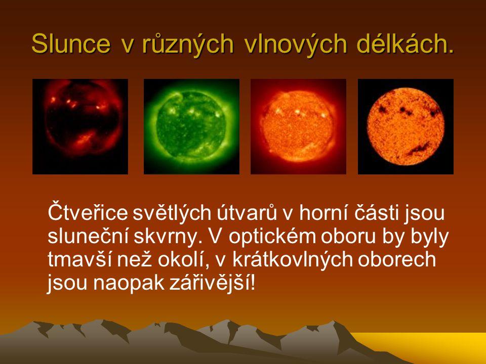 Slunce v různých vlnových délkách. Čtveřice světlých útvarů v horní části jsou sluneční skvrny.