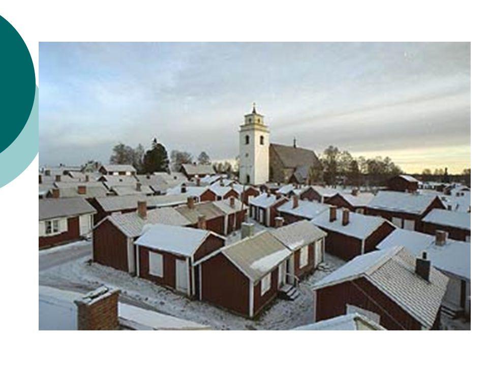 Městečko Gammelstad  na severu Botnického zálivu  zachovalé církevní město  Kolem kamenného kostela z 15. století je asi 424 dřevěných domků, které