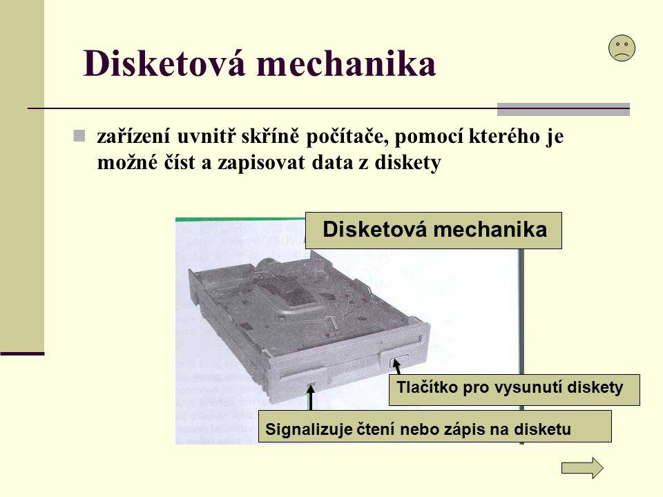 Disketová mechanika zařízení uvnitř skříně počítače, pomocí kterého je možné číst a zapisovat data z diskety Tlačítko pro vysunutí diskety Disketová m