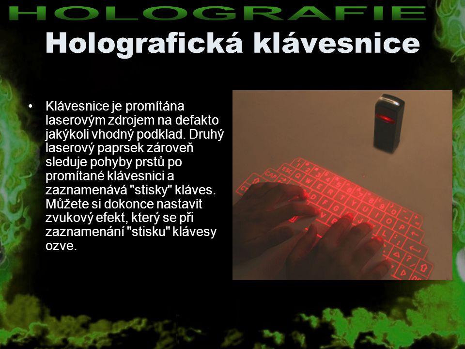 Holografická klávesnice Klávesnice je promítána laserovým zdrojem na defakto jakýkoli vhodný podklad. Druhý laserový paprsek zároveň sleduje pohyby pr