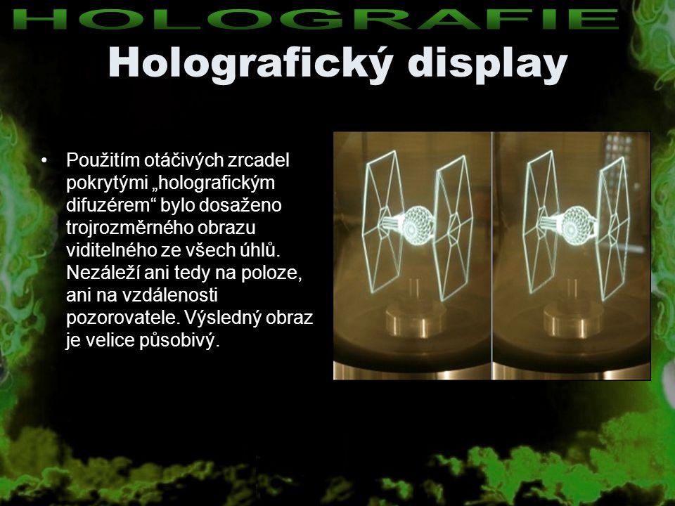 """Holografický display Použitím otáčivých zrcadel pokrytými """"holografickým difuzérem"""" bylo dosaženo trojrozměrného obrazu viditelného ze všech úhlů. Nez"""