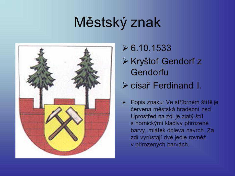 Městský znak  6.10.1533  Kryštof Gendorf z Gendorfu  císař Ferdinand I.  Popis znaku: Ve stříbrném štítě je červena městská hradební zeď. Uprostře