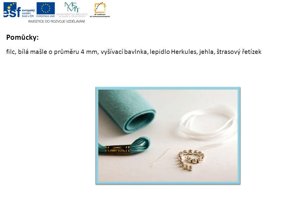 Pomůcky: filc, bílá mašle o průměru 4 mm, vyšívací bavlnka, lepidlo Herkules, jehla, štrasový řetízek