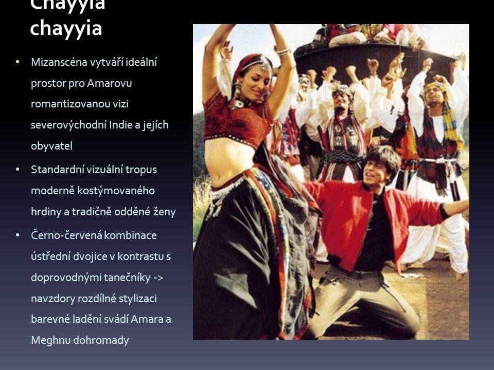 Mizanscéna vytváří ideální prostor pro Amarovu romantizovanou vizi severovýchodní Indie a jejích obyvatel Standardní vizuální tropus moderně kostýmovaného hrdiny a tradičně odděné ženy Černo-červená kombinace ústřední dvojice v kontrastu s doprovodnými tanečníky -> navzdory rozdílné stylizaci barevné ladění svádí Amara a Meghnu dohromady
