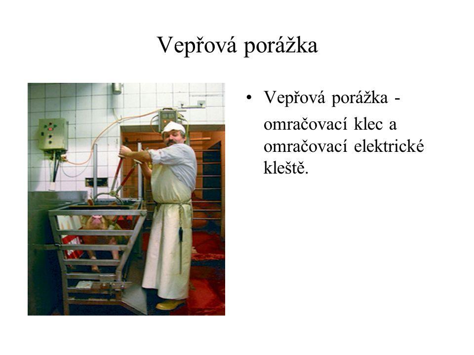 Vepřová porážka Vepřová porážka - omračovací klec a omračovací elektrické kleště.