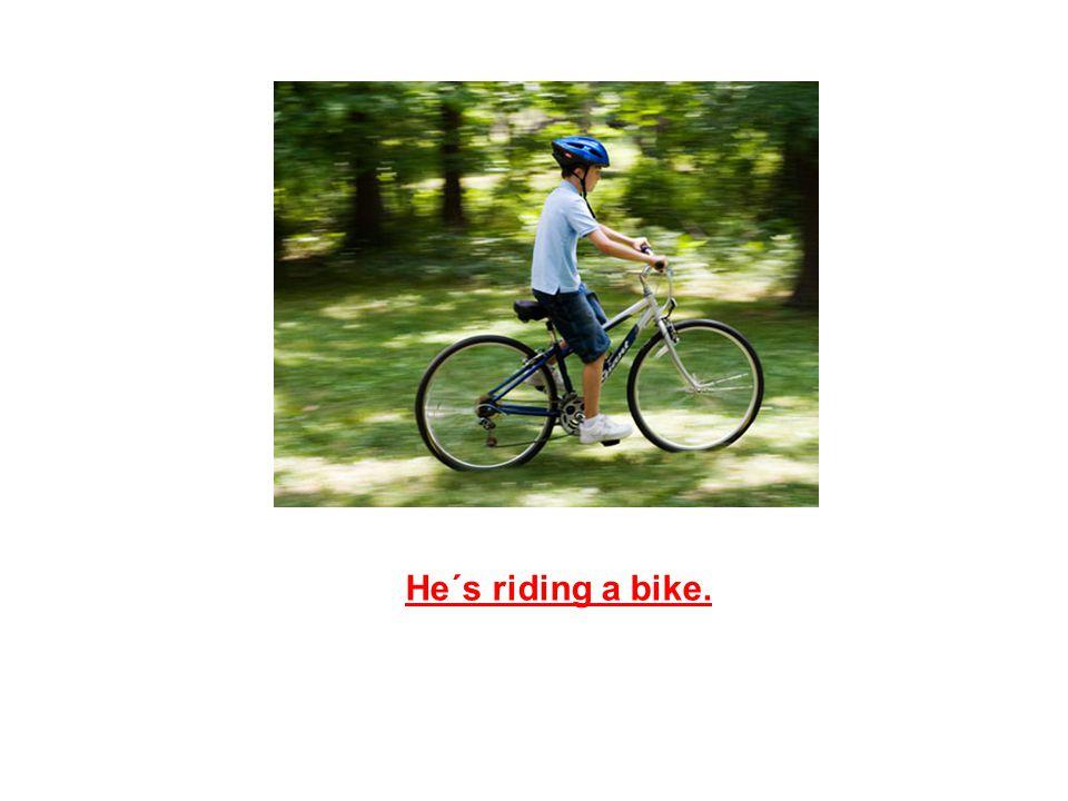He´s riding a bike.
