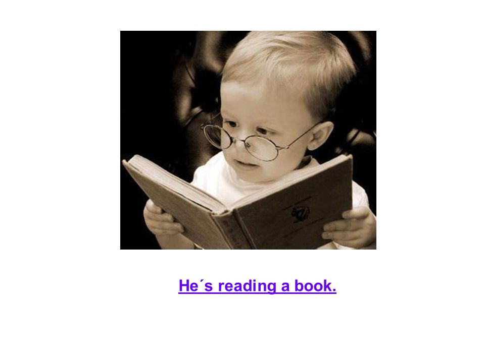 He´s reading a book.
