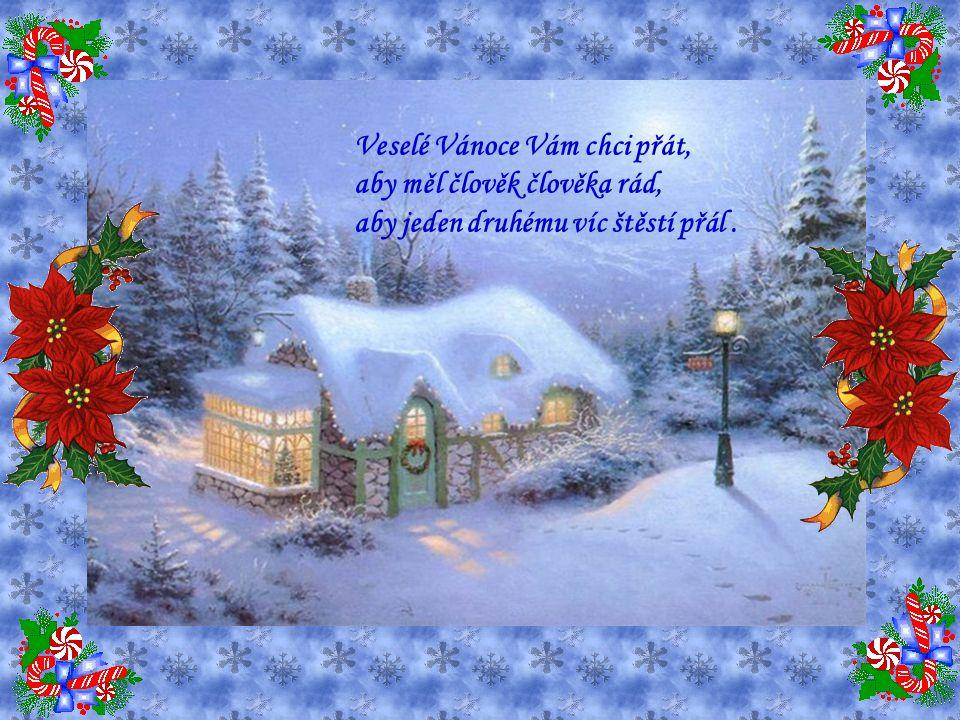 Oheň v krbu tiše praská. V tvém srdci ať je mír a láska. Z oblohy se sype sníh, vločky tančí v závějích.
