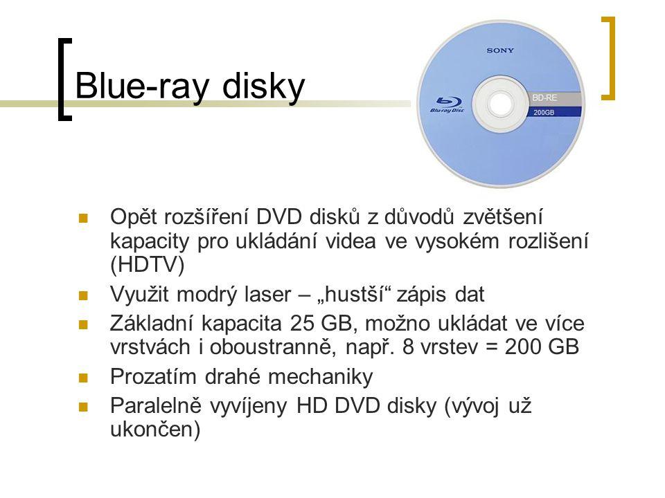 """Blue-ray disky Opět rozšíření DVD disků z důvodů zvětšení kapacity pro ukládání videa ve vysokém rozlišení (HDTV) Využit modrý laser – """"hustší"""" zápis"""