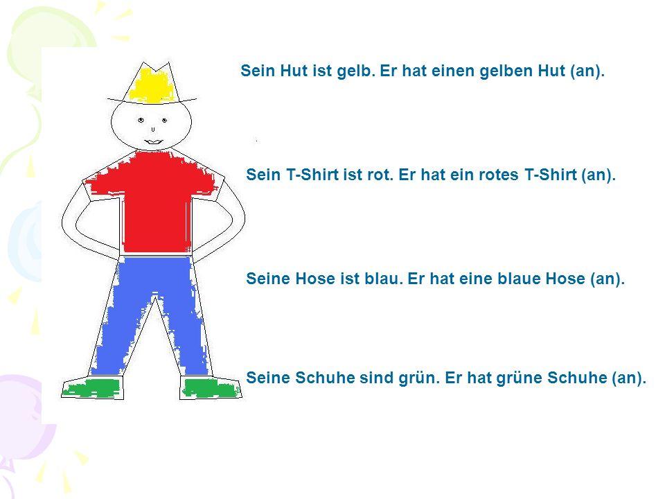 Sein Hut ist gelb. Er hat einen gelben Hut (an). Sein T-Shirt ist rot.