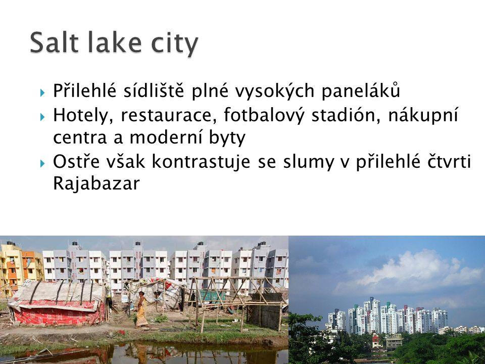  Přilehlé sídliště plné vysokých paneláků  Hotely, restaurace, fotbalový stadión, nákupní centra a moderní byty  Ostře však kontrastuje se slumy v přilehlé čtvrti Rajabazar