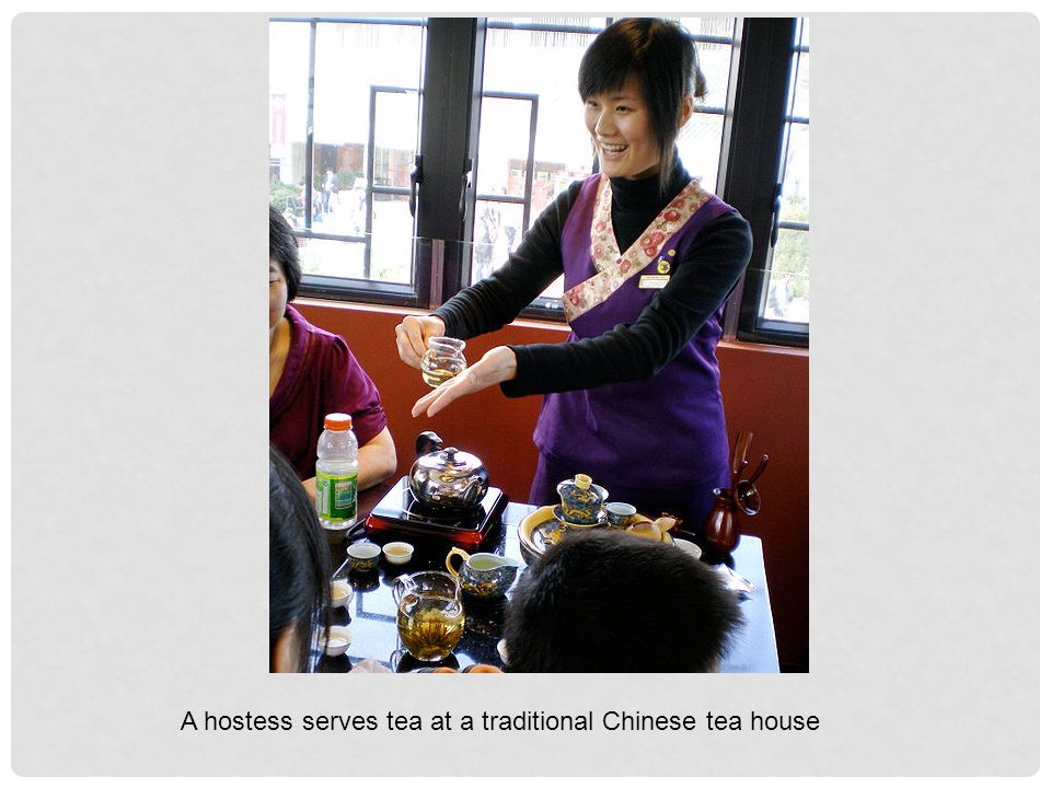 A hostess serves tea at a traditional Chinese tea house