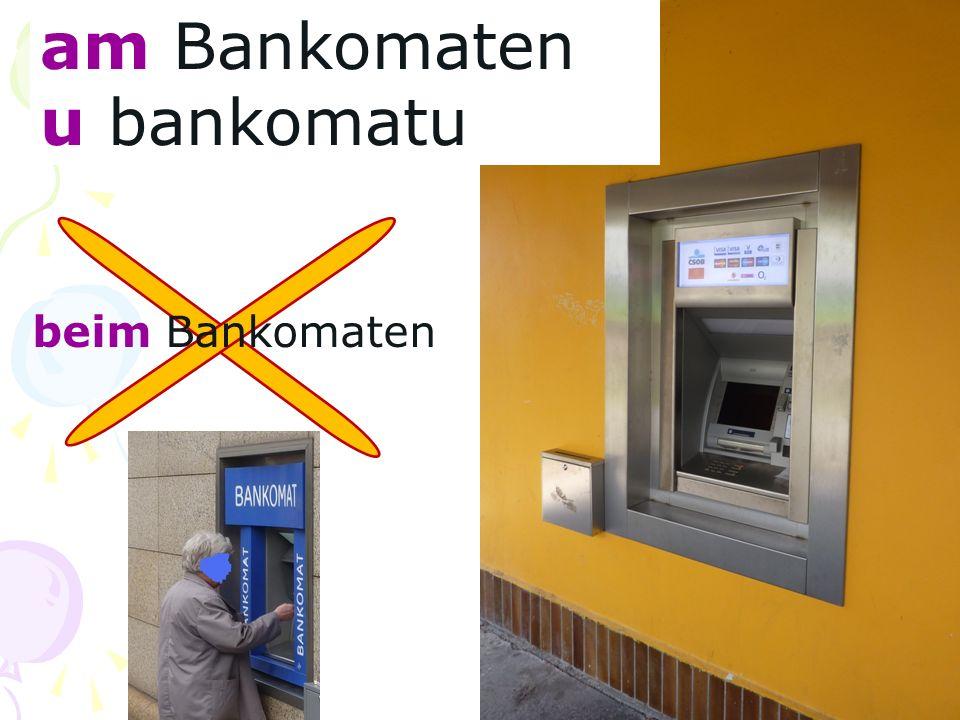 am Bankomaten u bankomatu beim Bankomaten