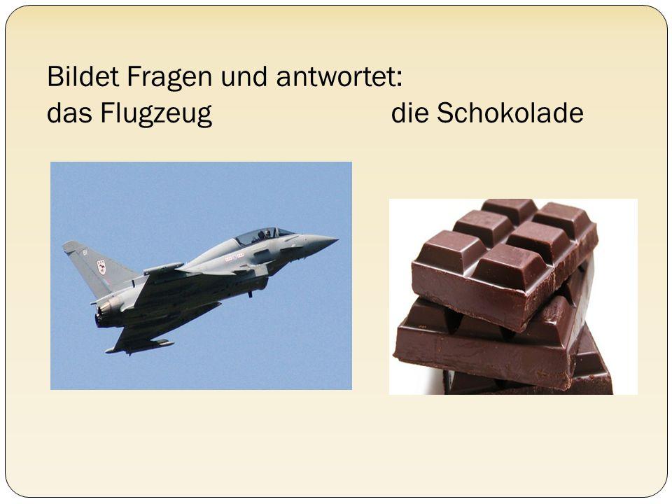 Bildet Fragen und antwortet: das Flugzeug die Schokolade