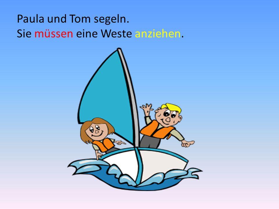 Paula und Tom segeln. Sie müssen eine Weste anziehen.
