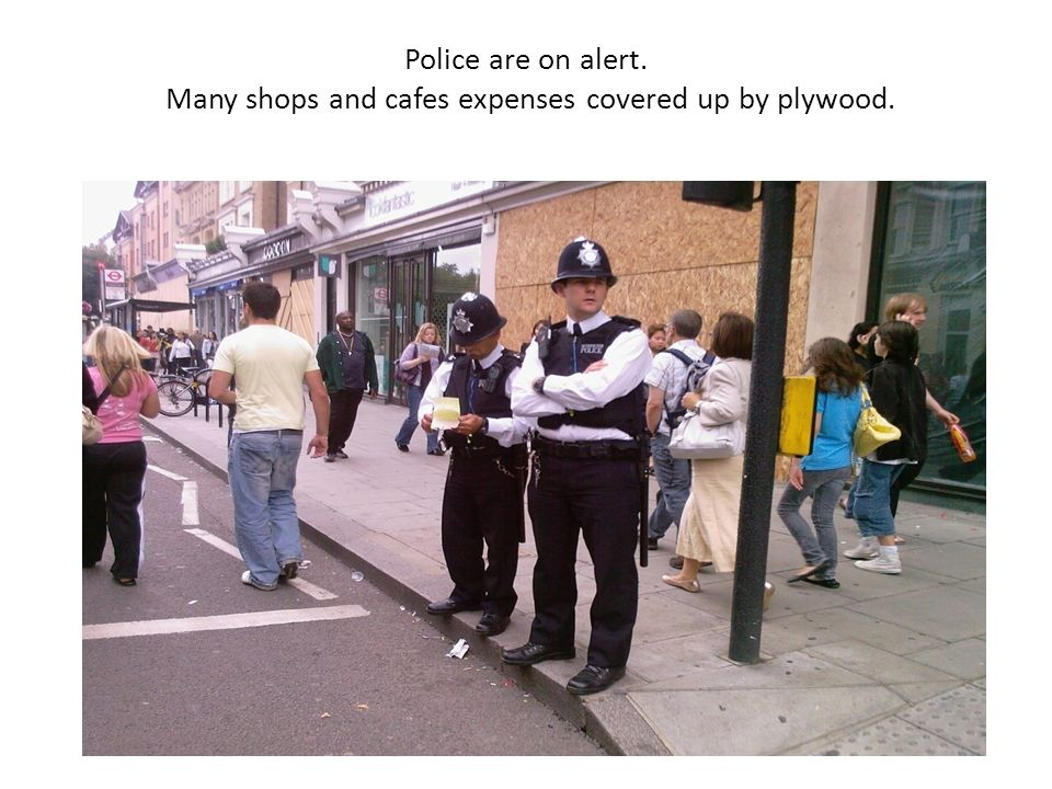 Police are on alert. Many shops and cafes expenses covered up by plywood.