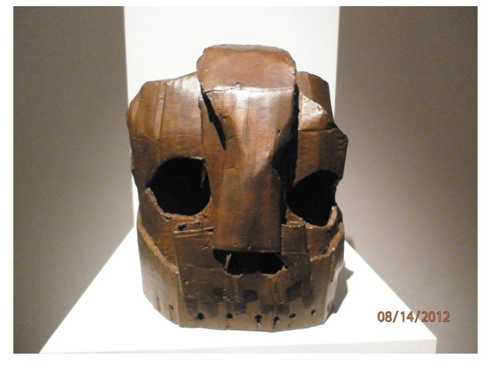 Co vidíte na fotografii.Jakým způsobem a z jakého materiálu je předmět vytvořen.