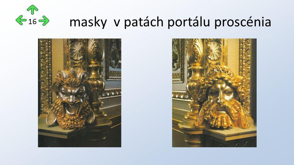 masky v patách portálu proscénia 16