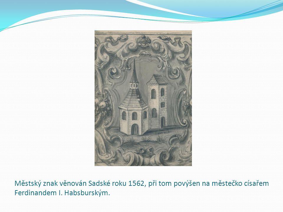 Městský znak věnován Sadské roku 1562, při tom povýšen na městečko císařem Ferdinandem I.