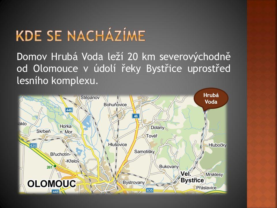 Domov Hrubá Voda leží 20 km severovýchodně od Olomouce v údolí řeky Bystřice uprostřed lesního komplexu.