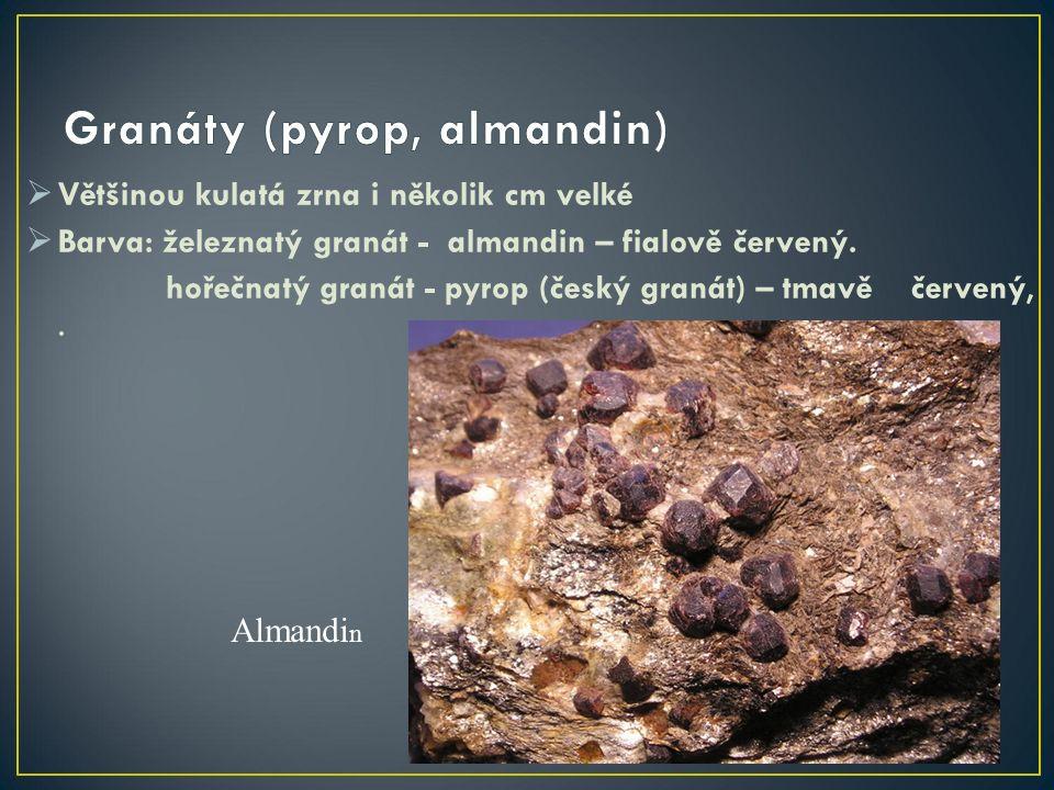  Většinou kulatá zrna i několik cm velké  Barva: železnatý granát - almandin – fialově červený.