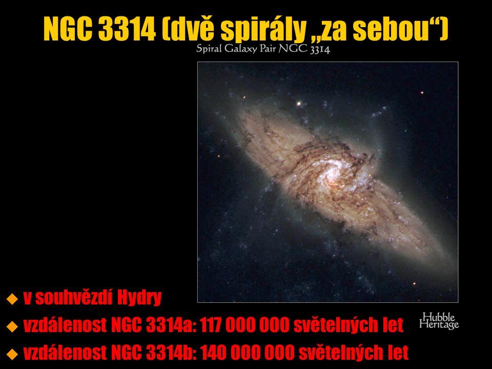 """NGC 3314 (dvě spirály """"za sebou ) u u v souhvězdí Hydry u u vzdálenost NGC 3314a: 117 000 000 světelných let u u vzdálenost NGC 3314b: 140 000 000 světelných let"""
