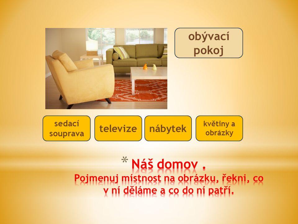 obývací pokoj sedací souprava televizenábytek květiny a obrázky