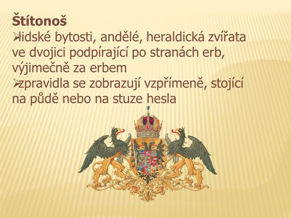 Štítonoš  lidské bytosti, andělé, heraldická zvířata ve dvojici podpírající po stranách erb, výjimečně za erbem  zpravidla se zobrazují vzpřímeně, s