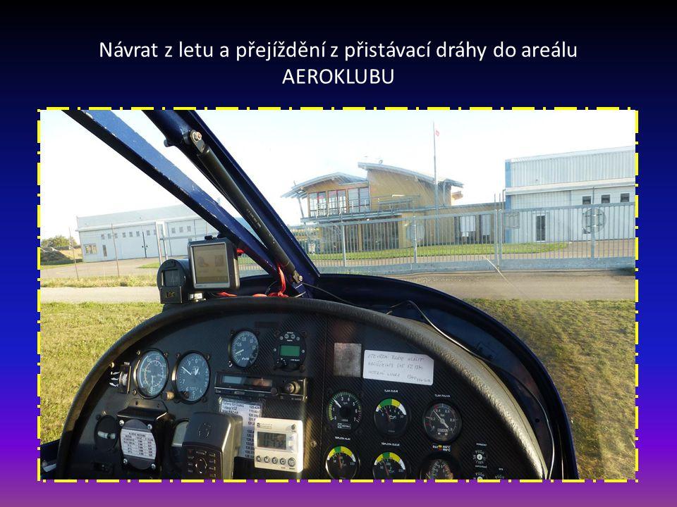 Návrat z letu-první dotyk podvozku letounu na přistávací dráhu letiště