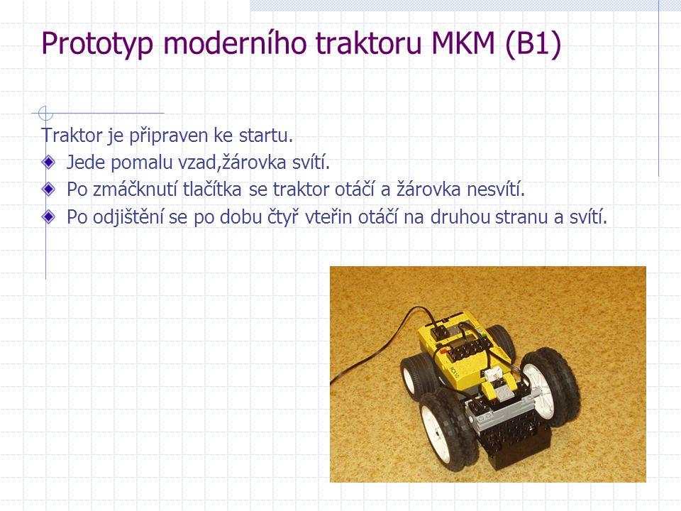 Prototyp moderního traktoru MKM (B1) Traktor je připraven ke startu. Jede pomalu vzad,žárovka svítí. Po zmáčknutí tlačítka se traktor otáčí a žárovka