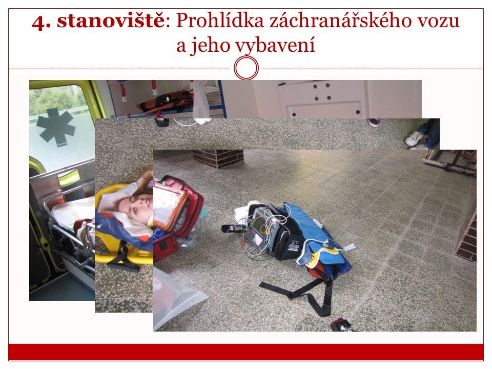 4. stanoviště: Prohlídka záchranářského vozu a jeho vybavení  Záchranář nám předvedl vybavení a jeho praktické využití.