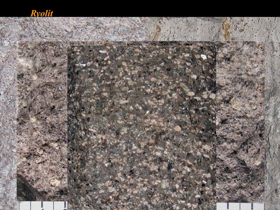 Trachyt • chemickým složením odpovídá syenitu • téměř bez křemene 0 – 5 % • převážnou část světlých minerálů tvoří živce • s porfyrickou strukturou - vyrostlice sanidinu, biotitu, amfibolu i pyroxenu • základní hmota s holokrystalickou nebo hemikrytalickou strukturou • barva horniny je šedobílá, nažloutlá • tmavé minerály M = 10 – 35 % (biotit, amfibol, pyroxen) • použití v kamenictví