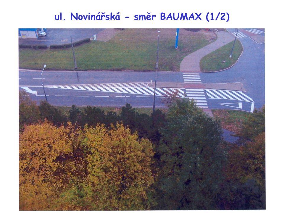 """ul. Novinářská - směr BAUMAX (1/2) Chybí stop čáry (V6a) a """"šrafy"""" (V13) na prstenci"""