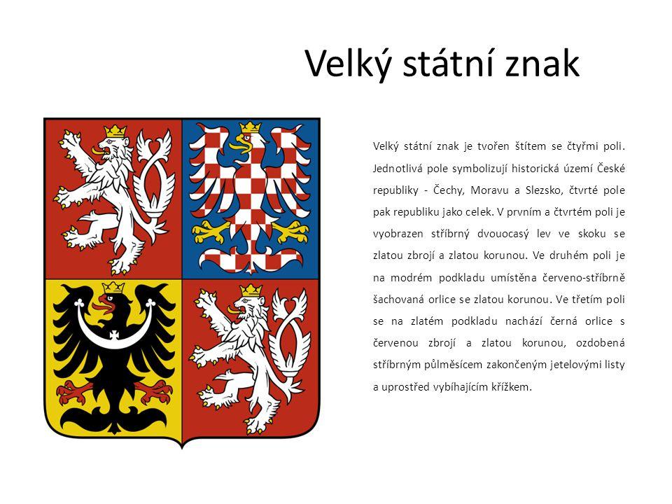 Malý státní znak Malý státní znak je tvořen jediným polem, na němž je umístěn na červeném podkladu stříbrný dvouocasý lev ve skoku se zlatou zbrojí a zlatou korunou.
