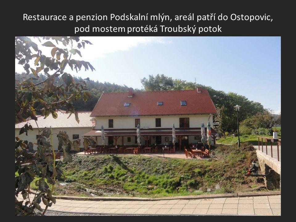 Restaurace a penzion Podskalní mlýn, areál patří do Ostopovic, pod mostem protéká Troubský potok