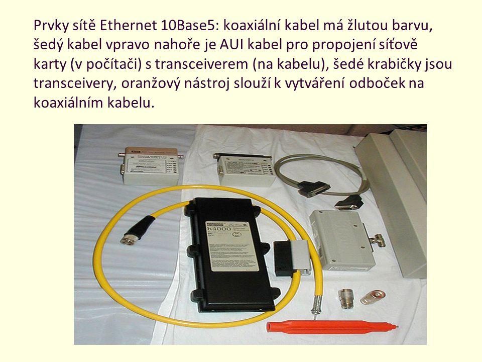 Prvky sítě Ethernet 10Base5: koaxiální kabel má žlutou barvu, šedý kabel vpravo nahoře je AUI kabel pro propojení síťově karty (v počítači) s transceiverem (na kabelu), šedé krabičky jsou transceivery, oranžový nástroj slouží k vytváření odboček na koaxiálním kabelu.
