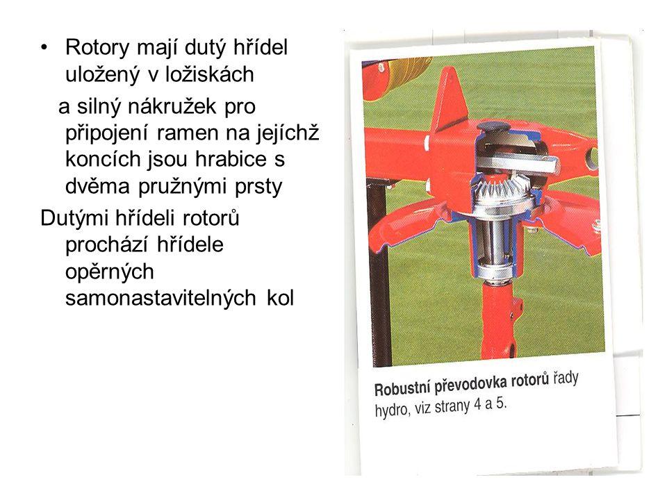 Rotory mají dutý hřídel uložený v ložiskách a silný nákružek pro připojení ramen na jejíchž koncích jsou hrabice s dvěma pružnými prsty Dutými hřídeli rotorů prochází hřídele opěrných samonastavitelných kol