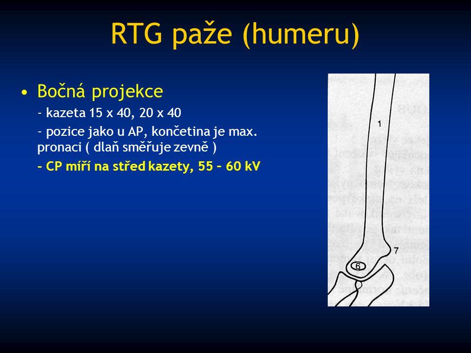 RTG paže (humeru) Bočná projekce - kazeta 15 x 40, 20 x 40 - pozice jako u AP, končetina je max. pronaci ( dlaň směřuje zevně ) - CP míří na střed kaz