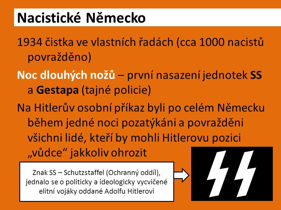 """1934 čistka ve vlastních řadách (cca 1000 nacistů povražděno) Noc dlouhých nožů – první nasazení jednotek SS a Gestapa (tajné policie) Na Hitlerův osobní příkaz byli po celém Německu během jedné noci pozatýkáni a povražděni všichni lidé, kteří by mohli Hitlerovu pozici """"vůdce jakkoliv ohrozit Nacistické Německo Znak SS – Schutzstaffel (Ochranný oddíl), jednalo se o politicky a ideologicky vycvičené elitní vojáky oddané Adolfu Hitlerovi"""